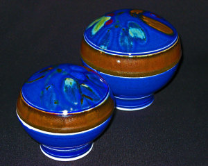 David and Felicity porcelain lidded boxes, blue glaze with brush decoration using iron, coblat and copper.